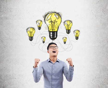 Asian man really happy because he has found solution for difficult problem. Concept of eureka. Stock Photo