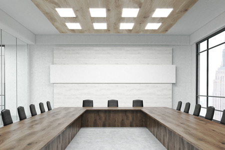 conference room: Interior of conference room with white banner, table, chairs and New York City view