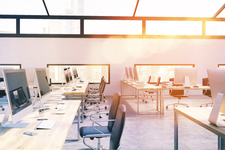office computer: Graphic design firm interior in attic office. Big city. Bright light. Computers on tables. Concept of corporate work. 3d rendering. Toned image
