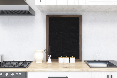 kitchen counter: Kitchen counter with blackboard and stove. Concept of cooking at home. 3d rendering. Mock up.