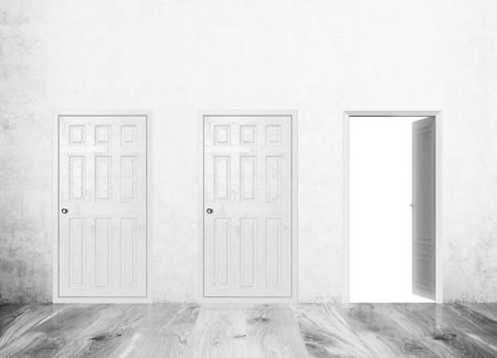 different ways: Corridor with three doors only one is open. Concrete wall, grey wood table. Concept of new decision and different ways to solve problems. Mock up