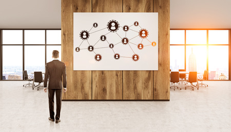 possibilities: Businessman in New York office standing in front of wooden wall with abstract sketch on it thinking about future possibilities. Concept of business development. 3d rendering. Toned image