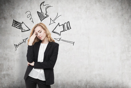 directive: Woman thinking hard. Arrows pointing at her from different directions. Concept of stressful day at work