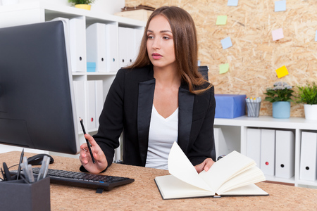 Upset business lady looking at computer screen with disappointment. Concept of failure at work Stock Photo