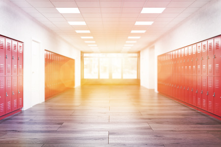 Red lockers in high school corridor.  Fitness Gym. Concept of learning and education. 3d rendering. Toned image 스톡 콘텐츠