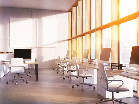 productive: Office room interior with computers on desks, city view through panoramic window and posters on wall. Concept of productive work. 3d rendering. Mockup. Toned image Stock Photo