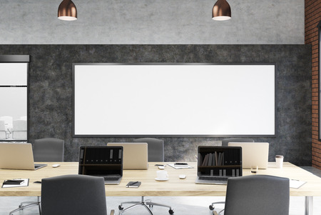 college class: College class or modern creative office interior with large whiteboard, wooden desks and laptops. Concept of modern education or modern office. 3d rendering. Mock up