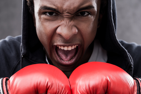 enraged: Enraged African  American boxer portrait. Concept of aggression and ways to cope with it.