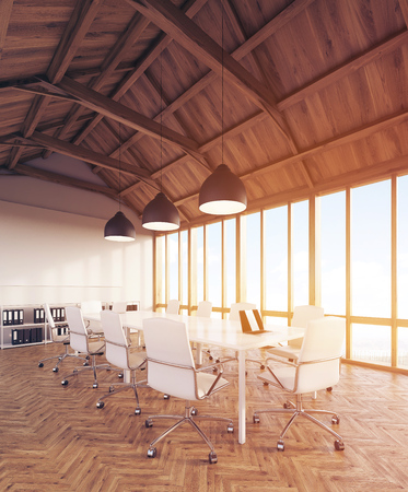 attic: Office interior in attic with computer tables, ceiling lamps and bookshelves with binders. Concept of modern company. 3d rendering. Toned image