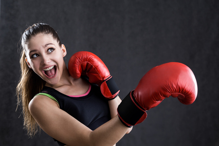 girl punch: Portrait of rookie boxer girl afraid to take punch in face. Concept of starting going in for sports.