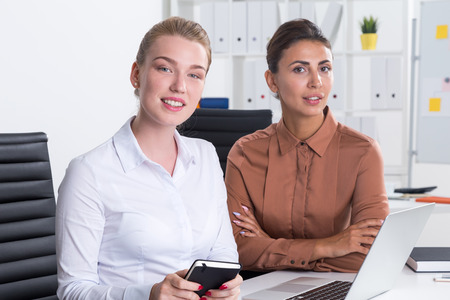 comprehend: Two businesswomen looking at their colleague off camera not being able to comprehend limits of his stupidity. Concept of evaluation Stock Photo