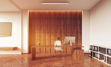 toning: Room with wooden wall, table with desktop, white bookshelves with binders and tv set on white wall. Concept of design studio. 3d rendering. Toned image Stock Photo