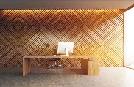 Wooden writing table with laptop. Wooden walls, concrete floor, panoramic windows. Concept of office interior. 3d rendering. Toned image