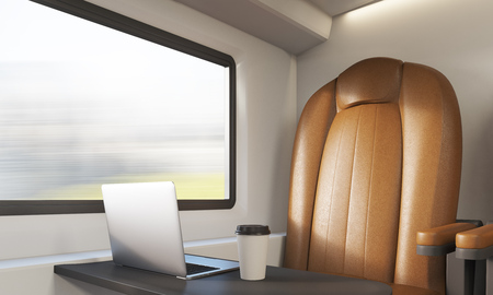 compartment: Corner of modern train compartment with comfortable leather armchair, laptop and coffee in paper cup. Concept of living in suburbs. 3d rendering Stock Photo