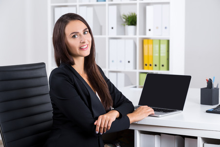 attend: Cheerful office worker looking at her colleage off camera and thinking about business training they are going to attend together.