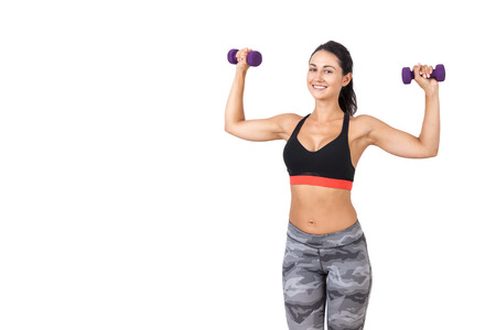 bad idea: Portrait of young lady in sweatpants holding dumbbells and smiling to the viewer. Concept of working on your muscles cant be a bad idea. Mock up