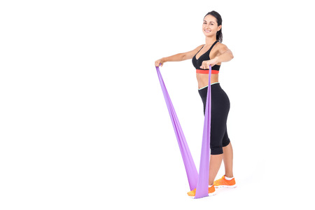 staying fit: Girl making an exercise with purple sport bandage. Concept of staying fit and active in any age. Mock up.