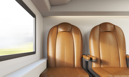 passenger compartment: View of two brown leather armchairs in modern train compartment. Window with blurred view. Concept of contemporary ways to travel