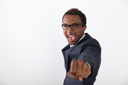 african business man: Very happy African American man with fist stretched to the viewer. Concept of charismatic business leader. Mock up Stock Photo