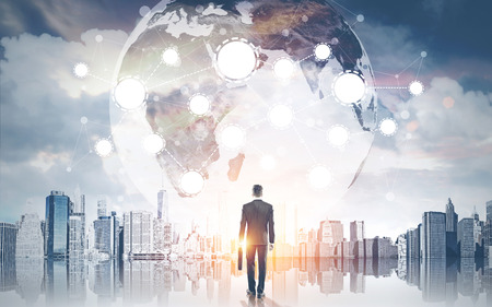 hallucination: Rear view of businessman with suitcase looking at giant Earth imaged that has emerged beside him. Concept of hallucination. Toned image. Double exposure Stock Photo