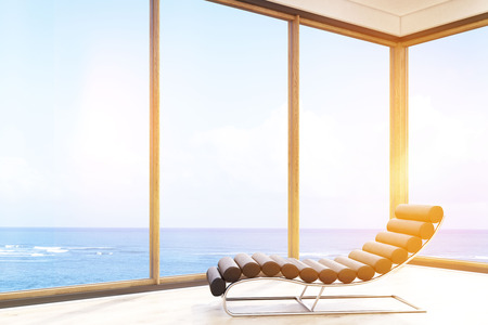 sea view: Massage chair in hotel room with ocean view and bright sunlight. Concept of vacation. 3d rendering. Toned image