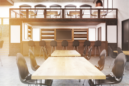 Close up of tables in bar interior with blackboard, vertical posters on walls and long tables with chairs. Concept of pub culture. 3d rendering, mock up, toned image