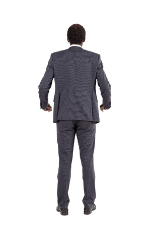 inability: Isolated rear view of African American businessman holding invisible railing near his waist. Concept of tension and stress at work and inability to relax and take it easy