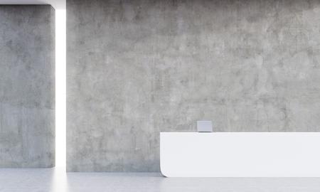 コンクリートの壁とテーブルの上のノート パソコンと空のオフィスで受付。黙示録のコンセプトです。3 d レンダリング、モックアップ