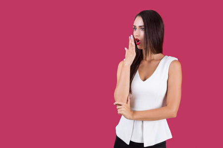 Very surprised young lady in white shirt and black skirt. Concept of strong emotions. Mock up