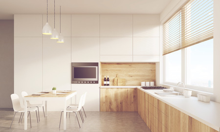 table surface: Front view of sunlit kitchen interior with working surface, family dining table and counter. Concept of family gathering. 3d rendering. Mock up. Toned image Stock Photo