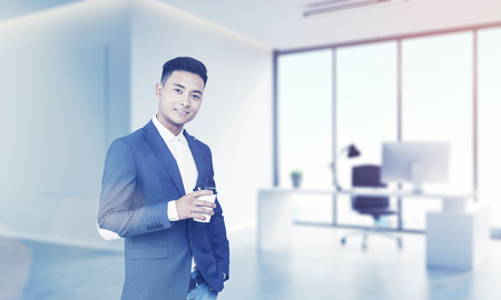 ceo: Portrait of successful Asian CEO posing in his office with computer and panoramic windows. Concept of excellent career. 3d rendering. Mock up