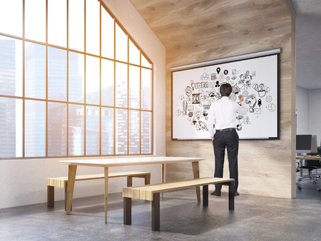 attic window: Man in office interior with whiteboard with business sketches, table and benches and attic window. New York City. Concept of office recreation area. 3d rendering.