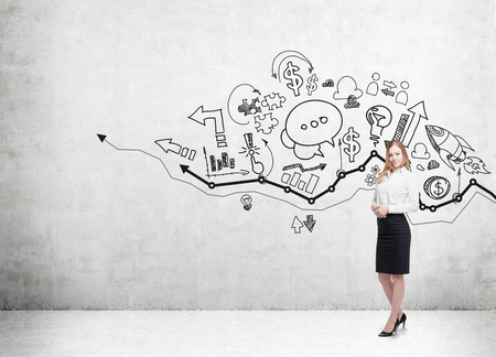 Blond girl standing near sketch wall with growing graph. Concept of business analysis. Mock up