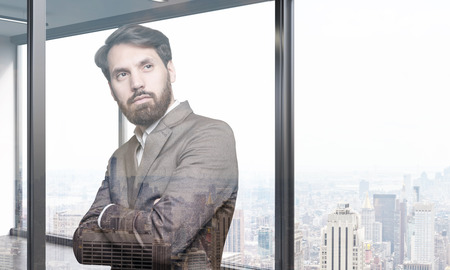 elimination: Bearded businessman dreaming about elimination of his competitioners in his large city apartment. Toned image. Double exposure