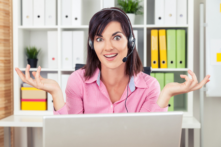 absurd: Confused help line operator doesnt know how to respond to clients question. Concept of absurd question and bewilderment. Stock Photo
