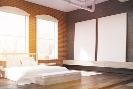 sunlit: Side view of sunlit bedroom with large clock on gray wall, massive bed and two posters. Concept of cozy room. 3d rendering. Toned image