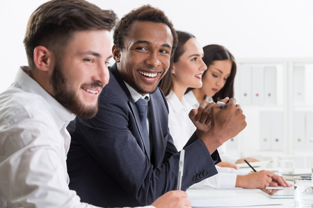 pointless: Smiling office workers having fun at annual meeting. Concept of communication and pointless events Stock Photo