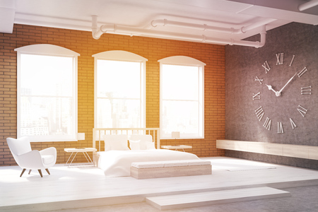 massive: Sunlit bedroom with large clock on gray wall, massive bed and an armchair. Concept of cozy home. 3d rendering. Stock Photo