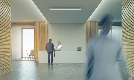 second floor: Rear view of two businessmen. One is entering the floor. The second is talking to blond secretary on reception. 3d rendering. Mock up. Toned image Stock Photo