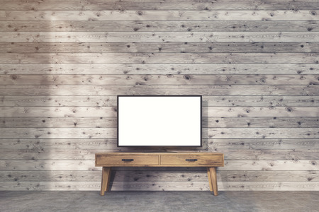 work table: Wide TV set with blank screen is standing on narrow table against boarded wall. Concept of advertising. 3d rendering. Mockup Stock Photo