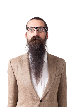 baffled: Baffled man wearing glasses and long beard is standing against white background. Concept of eccentric person.