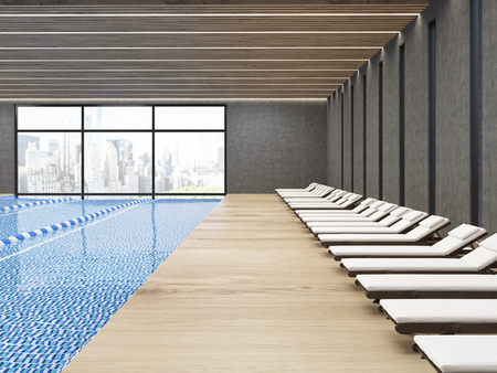 Public pool interior with chaise longues and wooden floor. City is seen through large windows. 3d rendering. Stock Photo