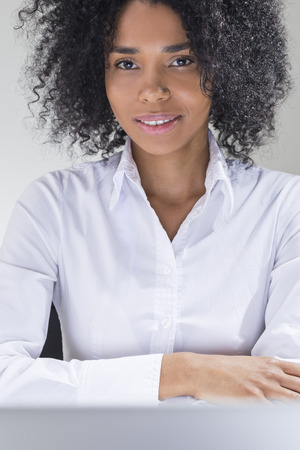 Smiling sexy woman from America looking at you and waiting to be asked out. Concept of tricky dating Stock Photo