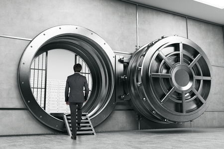 man rear view: Rear view of man in suit entering the vault of the bank. Concept of bank employee. 3d rendering. Stock Photo