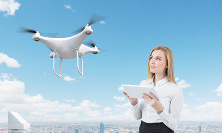 Portrait of blond young woman with tablet computer controlling a drone in large city. Concept of the future is now. 3d rendering. Mock up
