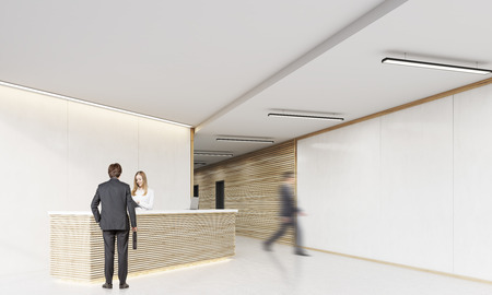 colleague: Rear view of man with suitcase standing near reception desk and talking to the secretary. His colleague is about to crash into the wall. 3d rendering. Mock up Stock Photo