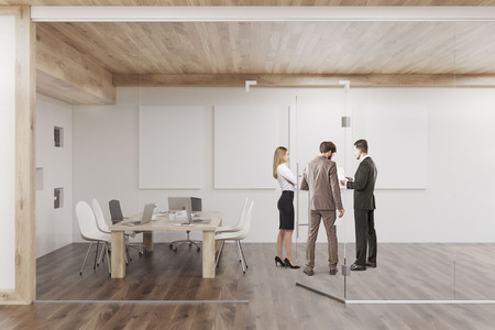 glass ceiling: People are standing in conference room with glass walls, four vertical posters and a wooden ceiling. Concept of teamwork. 3d rendering. Mock up Stock Photo