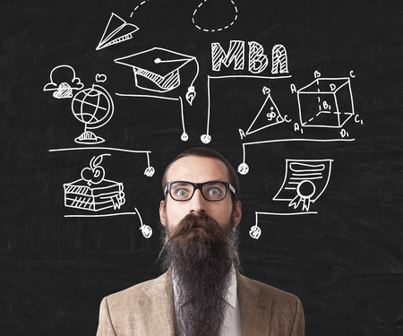 baffled: Baffled man with long beard is standing near blackboard with education icons. Concept of nuts professor