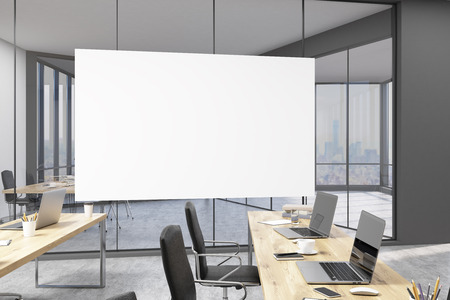 modern interior design: Large horizontal poster in office with glass doors and computers on wooden tables. Concept of modern art and interior design. 3d rendering.