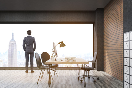 filing cabinet: Man looking at New York standing in  office with filing cabinet. CEO desk is standing near panoramic window with cityscape. 3d rendering. Mock up. Stock Photo